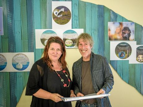 Dirtgirl creators Cate McQuillen and Hewey Eustace look over the plans for the soon to be completed sustainability learning facility.