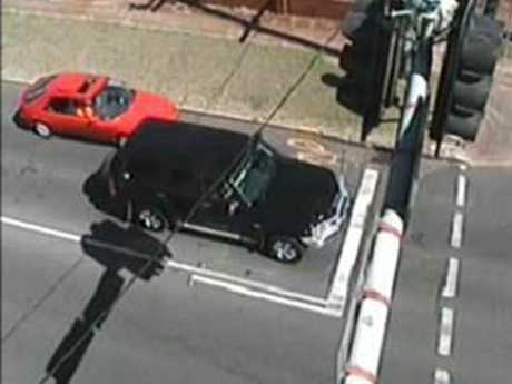 Police are looking for the driver of the red car.