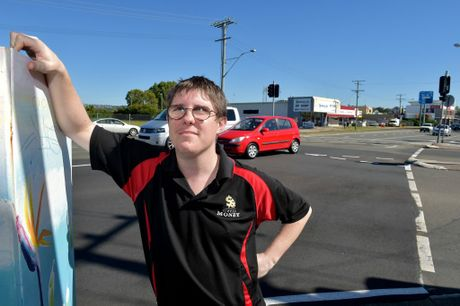 Metro Money pawn broker Cliff Mazzorana overlooks the intersection of Aerodrome Rd and First Ave