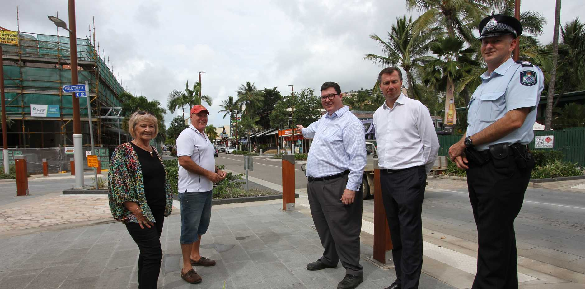 ON WATCH: Airlie Beach Councillor Jan Clifford, Whitsunday Coast Chamber of Commerce President Kevin Collins, Federal MP George Christensen, Minister for Justice Micheal Keenan and Officer in Charge of Whitsunday Police Senior Sergeant Nathan Blain surveying the main street where 52 of the 84 CCTV cameras will be installed.  Photo Sharon Smallwood / Whitsunday Times