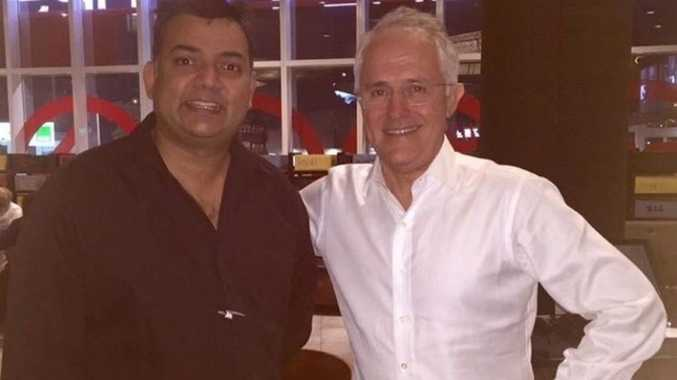 PM Malcolm Turnbull poses for a picture after eating at Ribs and Rumps in Rockhampton. Photo: Facebook