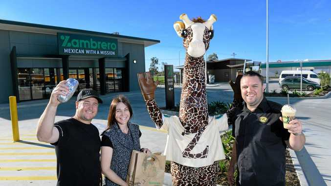 OPEN: Zambrero franchisees Ryan and Tamara Russell and Zarraffa's franchisee Jason Meares (right) at their new stores in Yamanto.