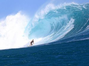 Big wave pair score big time in two different oceans