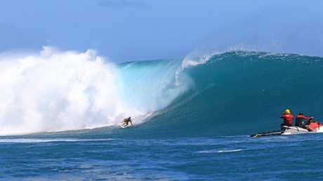 Anthony King, the Sunshine Coast Lifeguard supervisor, riding the biggest waves of his life at Cloudbreak in Fiji on the same day Aaron Gold, a big wave surfer from Hawaii, had to be revived after nearly drowining on a two-wave hold down.