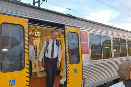ACTION: Sunshine Coast commuters Kieron Wallace and Jeff Addison (pictured front) want to see rail duplication.