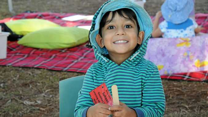Suhaan Chowdhury makes a ginger- bread stick man at one of the activity tables during the day.