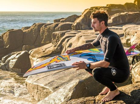 Surfer Jeames Young looks out over Turners Beach in preparation for this weekend's Yamba Surfing Festival.