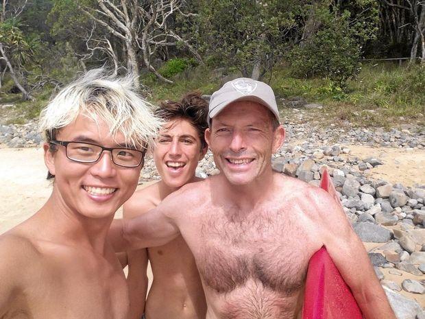 HITTING THE BEACH: Bongsu Kim (left) from South Korea and Finn Massoud with former Prime Minister Tony Abbott at Tea Tree Bay in Noosa National Park.