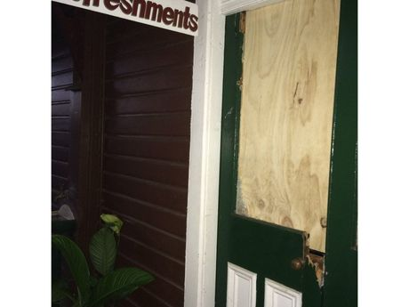 The Rattler Cafe is boarded up after vandals smashed doors and a window on Wednesday night