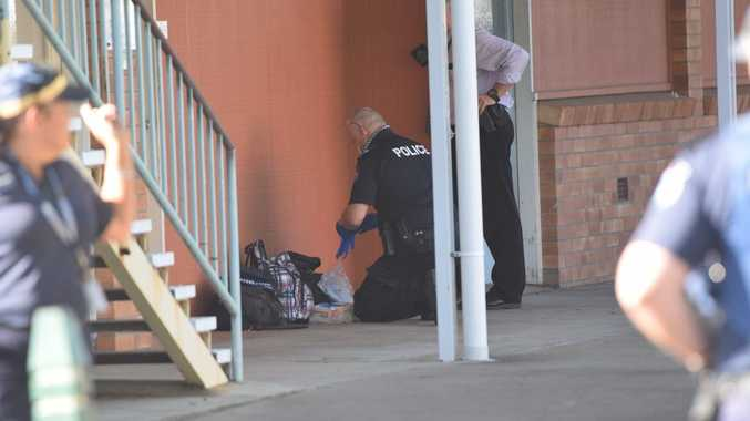 Police search an area off Woongarra St In Bundaberg. Photo: Craig Warhurst/News mail