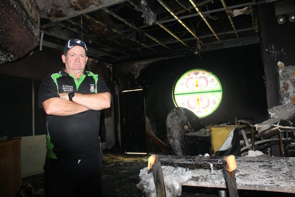 Greg Bird, the manager of the Australian Hotel in Ballina, checks over the extensive damage to the back bar and bistro area of the popular pub following a fire in the early hours of this morning, May 27. Photo: Graham Broadhead