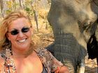 Sharon Pincott with an elephant named Whole as the elephant catches her 40 winks.