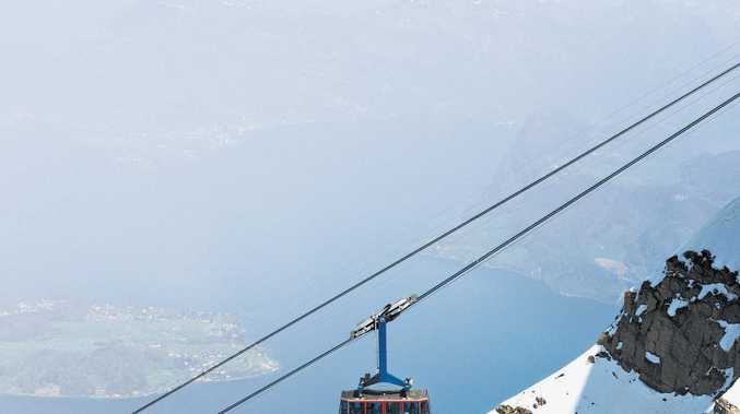 A cable car makes the ascent up Mt Pilatus in the Swiss Alps.