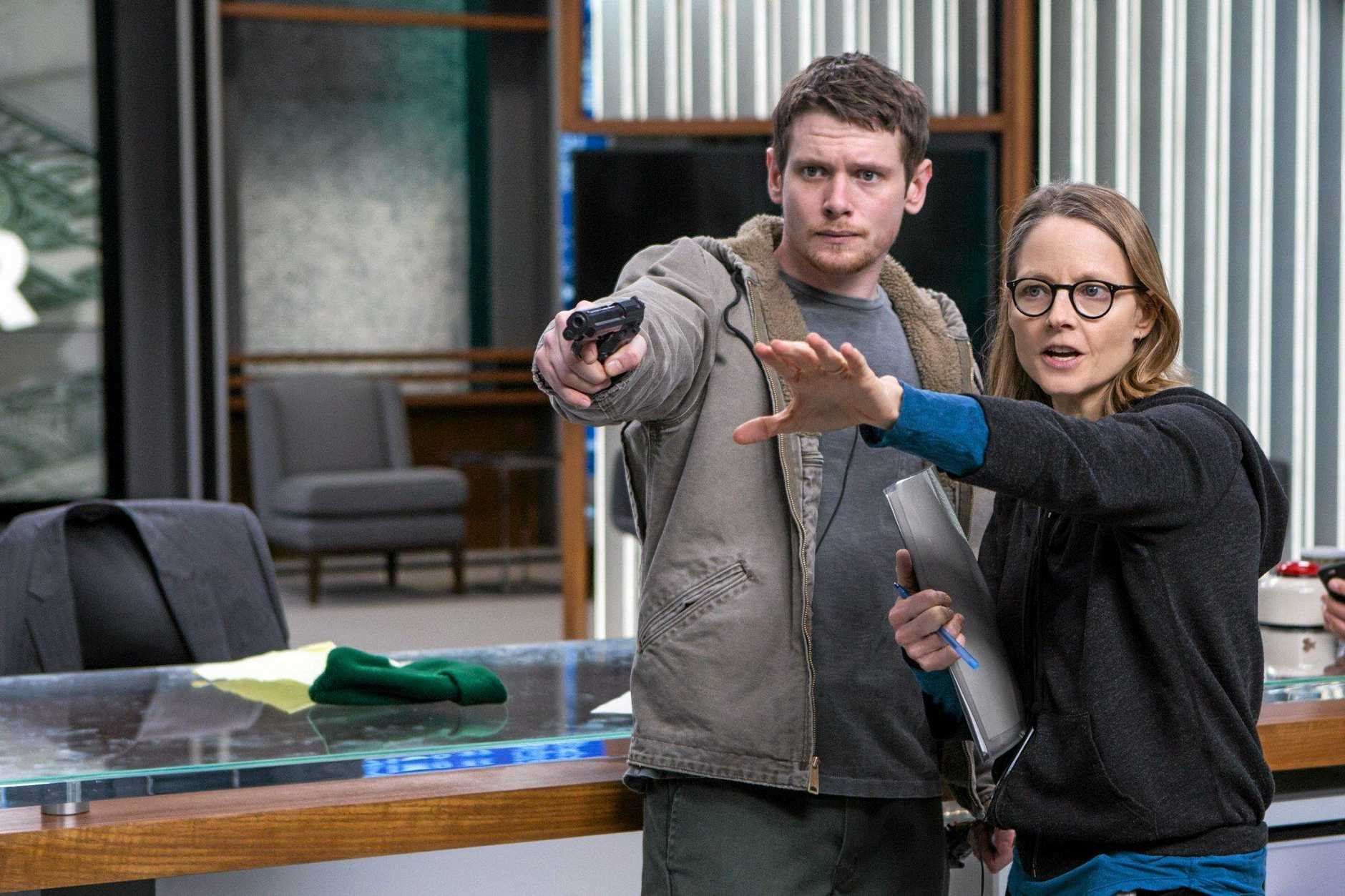 Jack O'Connell and director Jodie Foster on the set of the movie Money Monster.