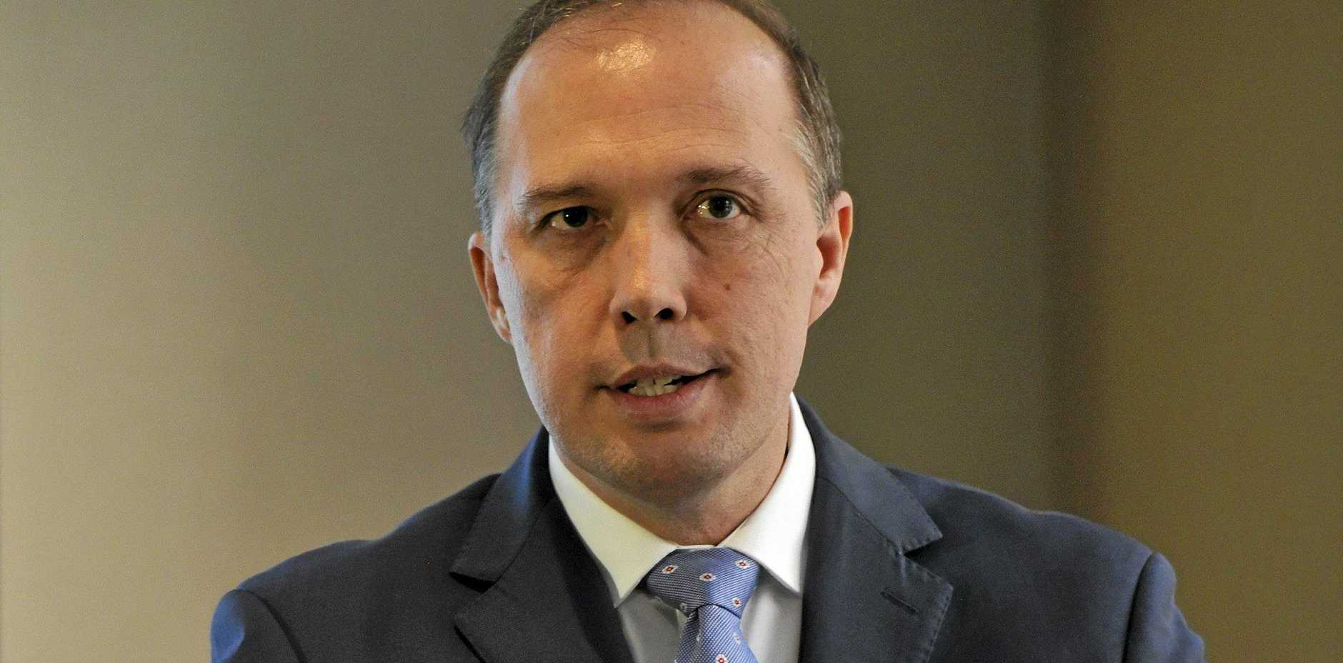 Minister for Immigration Peter Dutton speaks to the media in Sydney, Friday, April 29, 2016. (AAP Image/Joel Carrett)