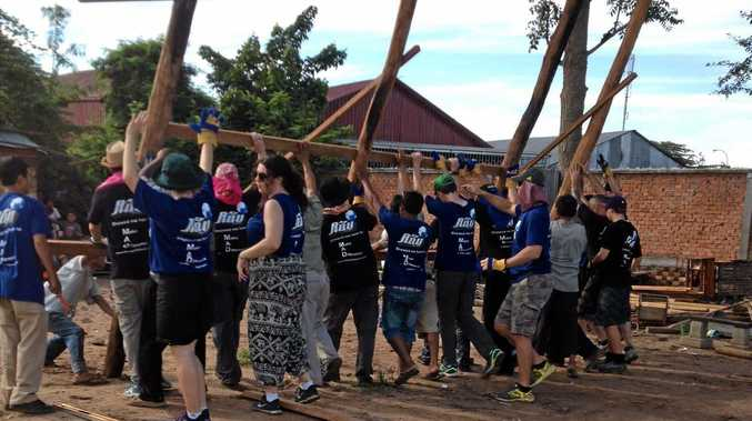 BUILDING GOODWILL: Members of the Dalby PCYC Youth Managment Team building houses in Cambodia.