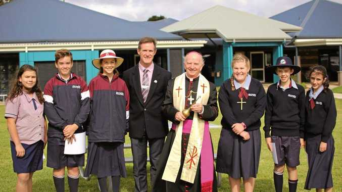 HISTORIC MOMENT: Celebrating the opening of the senior school are (from left) Felicity Connor, Bailey Skewes, Elly Close, principal Peter Murphy, Bishop Robert McGuckin, Anabel Austin, Tom Oldham and Jaymee Suliman.