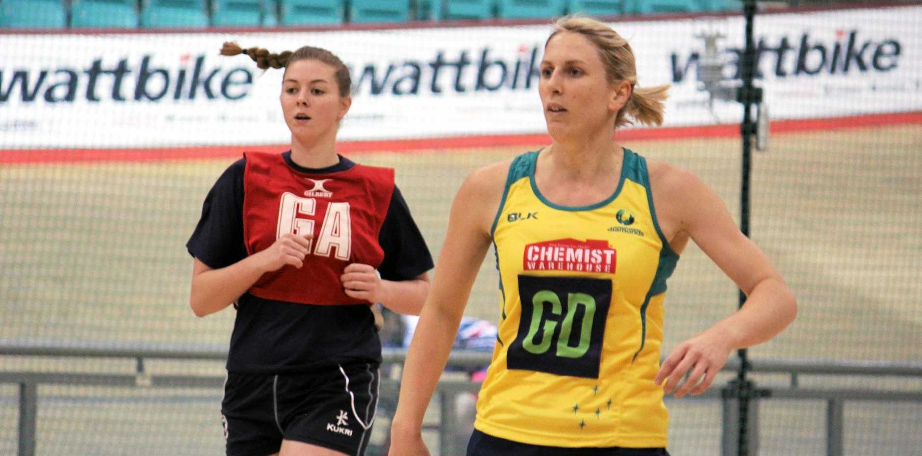 CAMP: Clare McMeniman, right, shows her style in a practice match in England for the Diamonds and will head to Canberra for a squad camp on Sunday.
