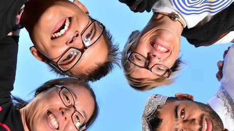 ONE PURPOSE: Huddling together are (clockwise, from left) Shine Jang, Bence Sandor, Fiona Anderson, Abdul Malik, Gary Meyer and Shahariah Hamid during the Sunshine Coast Community Conversation.