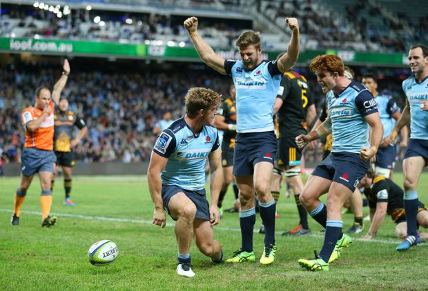 Michael Hooper of the Waratahs celebrates with his team mates after scoring his second try against the Chiefs  at Allianz stadium. Photo: AAP Image/David Moir