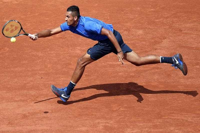 Nick Kyrgios of Australia in action against Richard Gasquet of France during their men's single third round match at the French Open tennis tournament at Roland Garros in Paris, France, 27 May 2016.