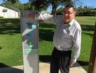 TIME'S UP: Fraser Coast Councillor David Lewis stands beside the now-obsolete ticket machine in the Main St/Charles St car park in Pialba.