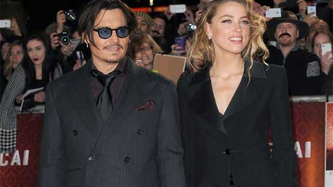 Amber Heard was granted a restraining order against Johnny Depp, who she is also divorcing.