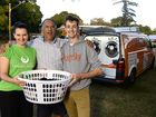 The Orange Sky laundry service offers free clothes and laundry services to those in need. QUU spokesperson Michelle Cull, resident Rickie Stuart and Orange Sky service rollout co-ordinator Alek Jacoby.