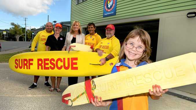 Felicity Moore, 5, celebrates the announcement of $20,000 for Fingal Surf Life Saving Club with volunteers Joel Slabb, Leanne Moore, David Dempsey, Allen Wise and Richmond MP Justine Elliot.