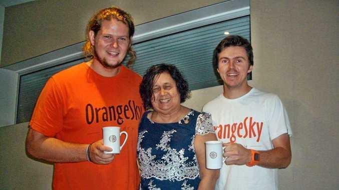 Rotarian Joy Unger thank Orange Sky Laundry's Nicholas Marchesi and Lucas  Patchett.