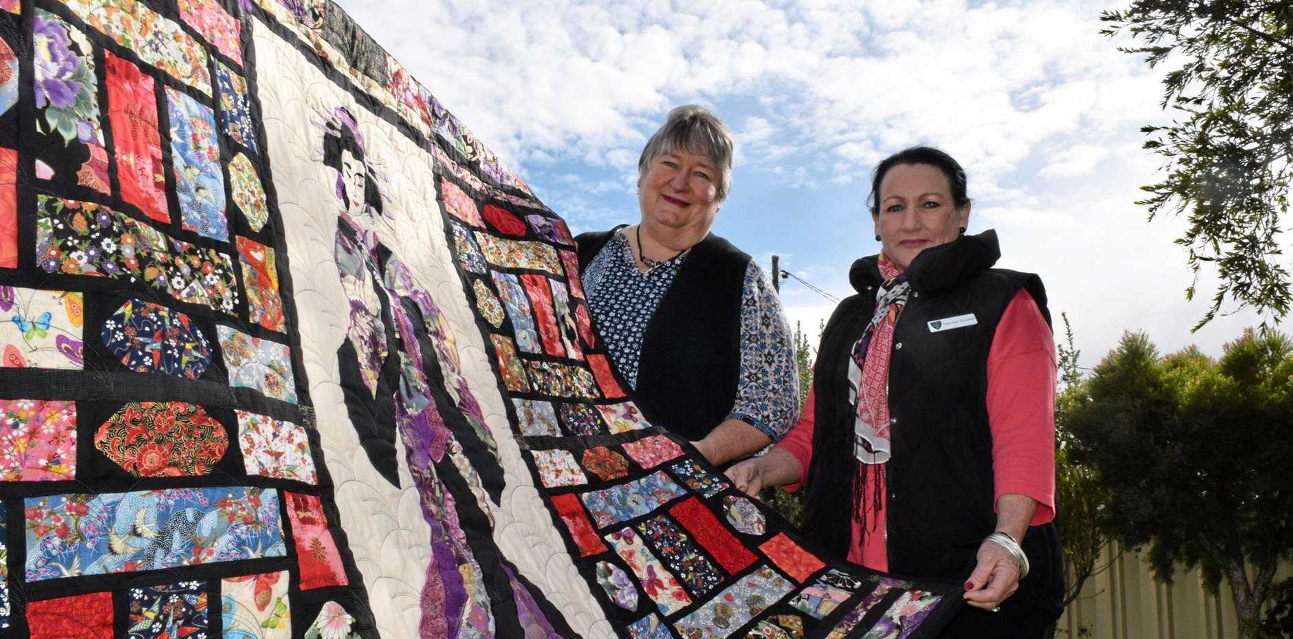 STITCH IN TIME: Artist Mavis Bunt will be raffling off one of her famous quilts to raise money for the Roma Hospital Auxiliary, which Marisa Grulke is a part of.