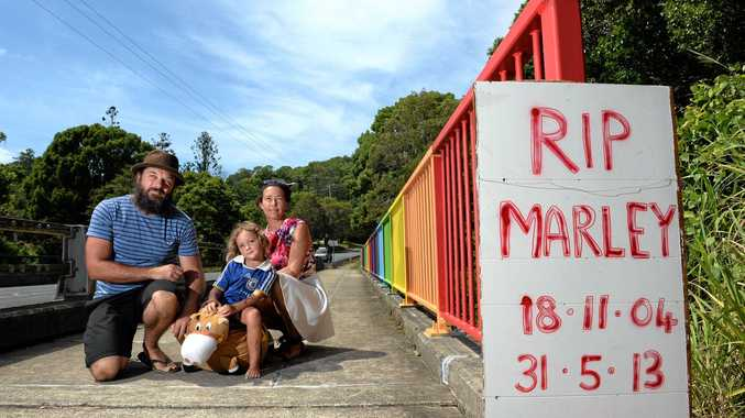 COLOURFUL MEMORIAL: File photo of Marley's family, David Cross, Abbyrose Cross and Raquel Morton, at the Kyogle Rd bridge, in November 2014, and below, an artist's impression of the new mural to be painted on the bridge.