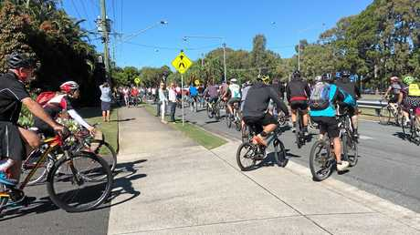 Caloundra cyclist and triathlete Scott Penny was farewelled today and given a two-wheel procession from Gregson and Weight Funeral Directors to Golden Beach.