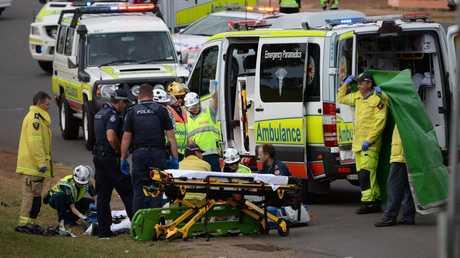 CRASH: Emergency services at the scene of a crash at the corner of Johnston and Bolewski St, Bundaberg. Photo: Mike Knott / NewsMail
