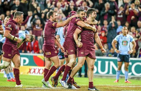 CELEBRATIONS: Aiden Guerra, Greg Inglis and Cameron Smith celebrate a try during Queensland's dominant victory in State of Origin Game III at Suncorp Stadium last year.