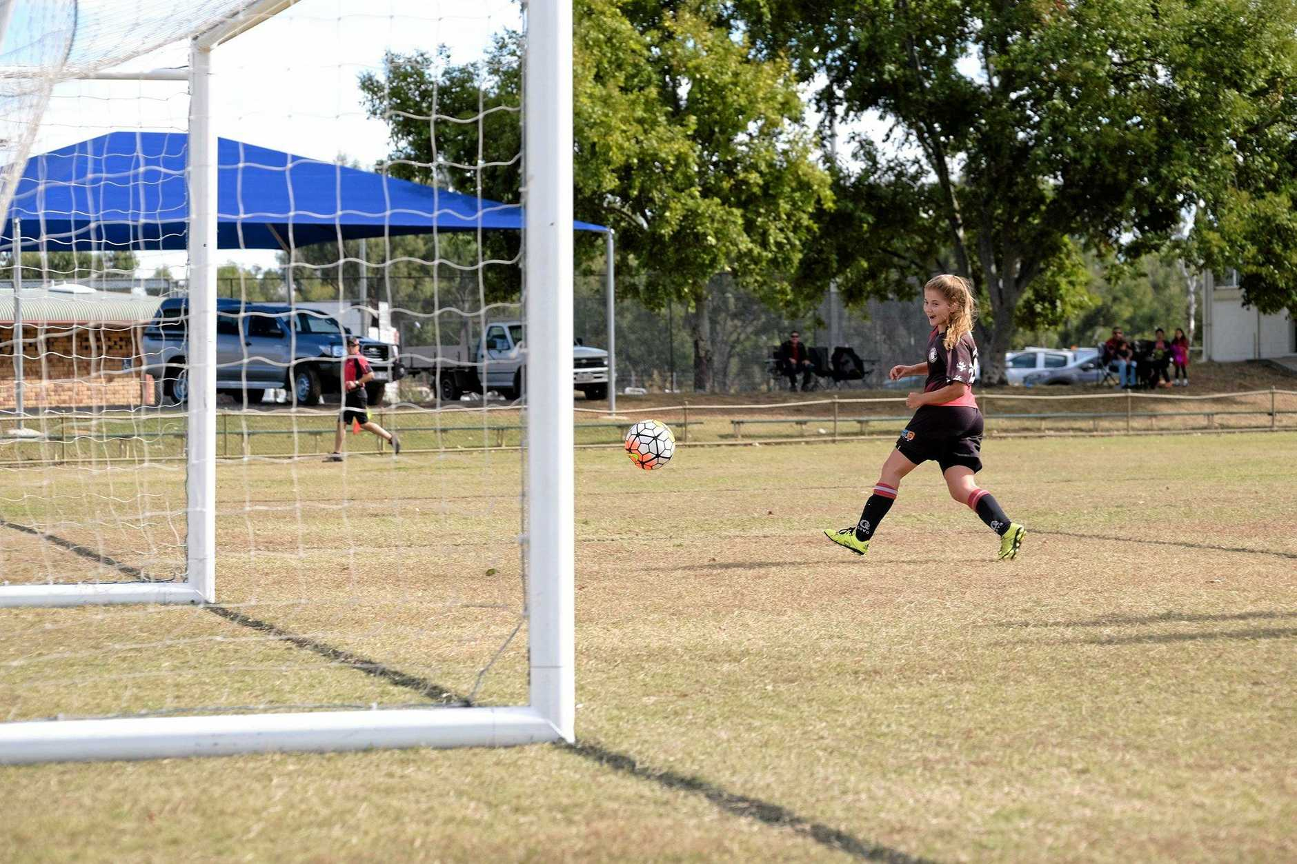 Sally Carroll scores after beating the Withcott goal keeper during the Honeybears v Pink Panthers match in Chinchilla on Sunday. 29/05/16
