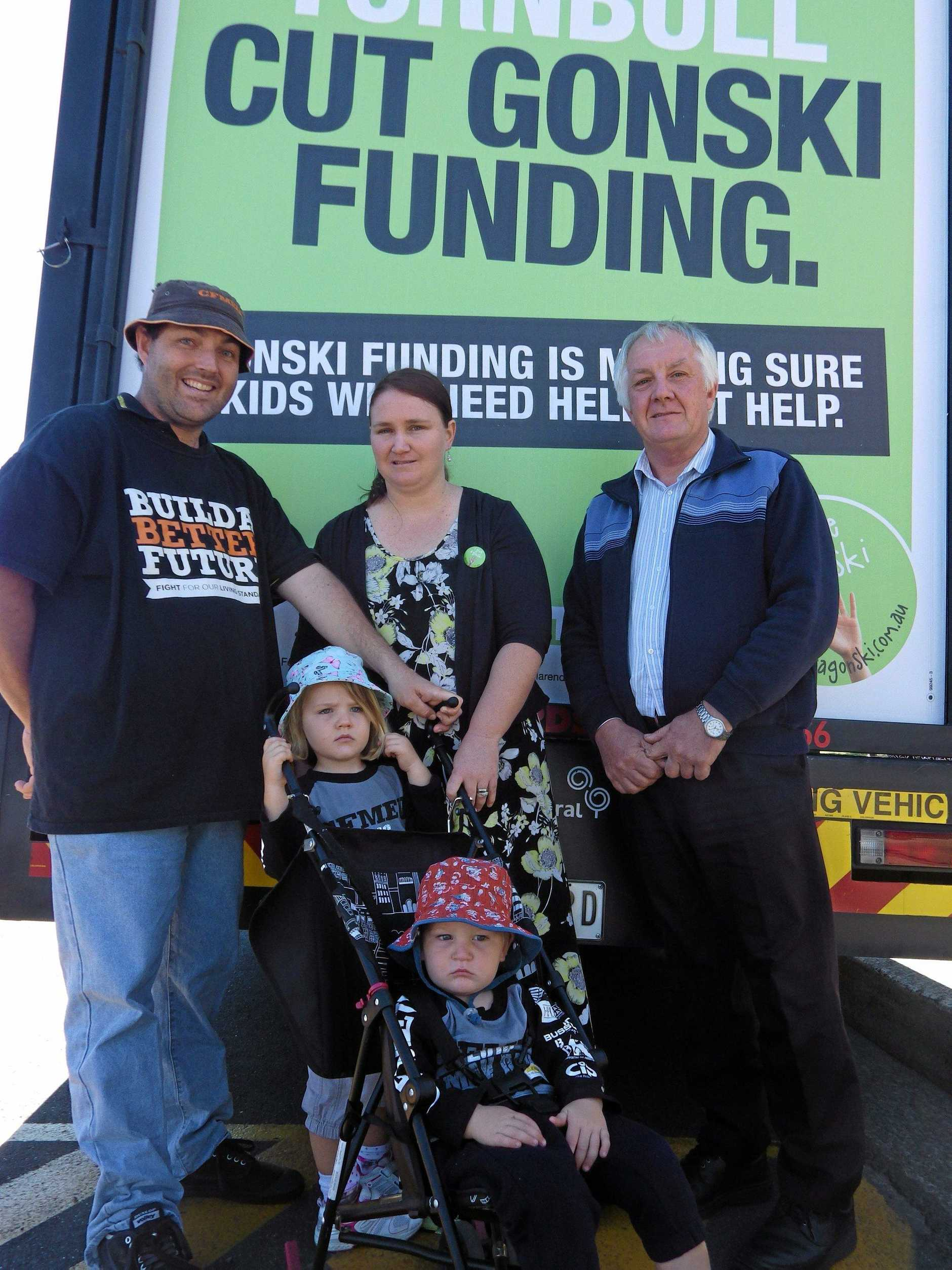 Gonski campaign outside Casino Public School.Parents Zeb and Melinda Russell with children Emma, 4, and Thomas, 2, with school principal Garry Carter.