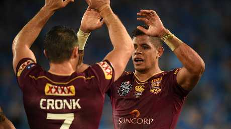 Dane Gagai of the Maroons, (right), celebrates with team mates after scoring a try during State of Origin Game I.