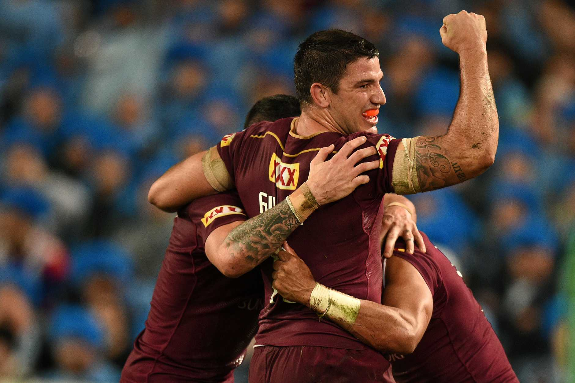 Matthew Gillett of the Maroons celebrates after Dane Gagai, (right), scored a try during State of Origin Game I between the NSW Blues and Queensland Maroons, at ANZ Stadium in Sydney on Wednesday, June 1, 2016. (AAP Image/Dan Himbrechts)