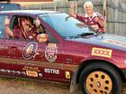 GO THE MAROONS: Shane Jacob and friend Kate Dansey with his Queensland-inspired Ford Falcon in Moore Park yesterday.
