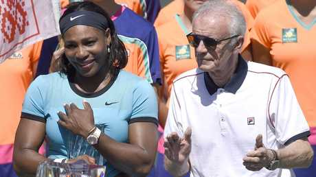 US tennis player Serena Williams (L) stands with Raymond Moore.