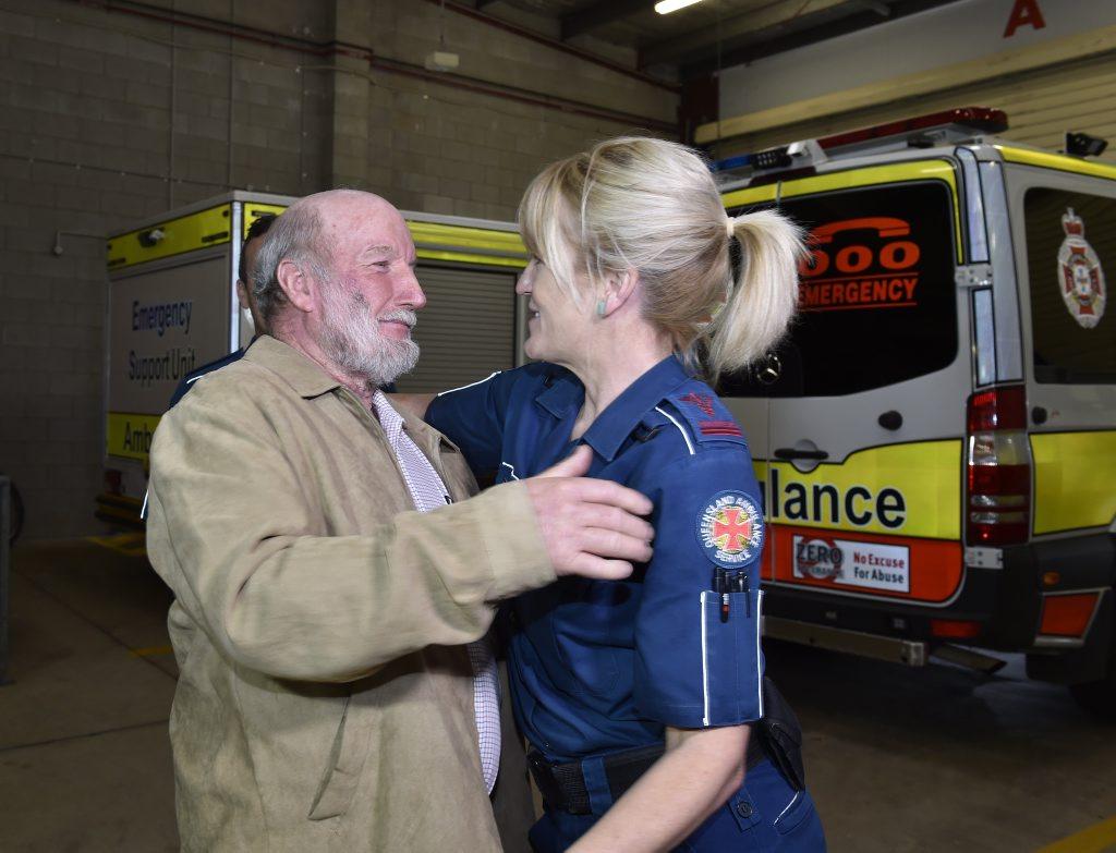 An emotional Gary Turvey, with advanced care paramedic Jo Crooks.