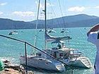 CLOSE CALL: Whitsunday Escape operations manager Wesley Cole and Queensland Charter Yachts managing director Christophe Vanek battle to get the Lagoon 440 to safety.