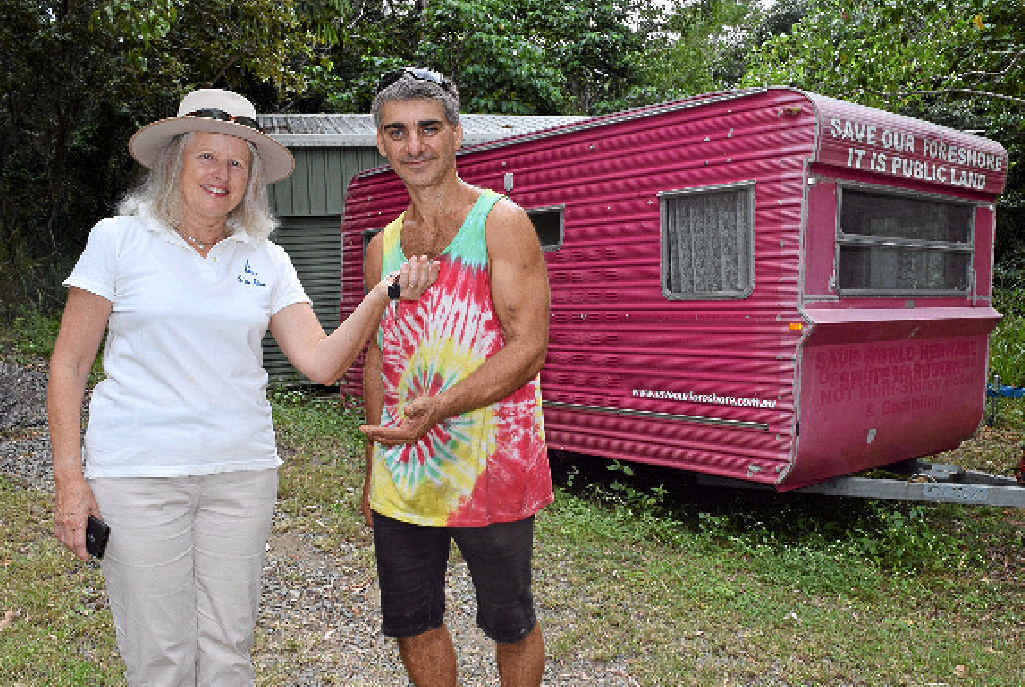 HAND OVER: Save Our Foreshore president Suzette Pelt hands over SOFI the caravan to Frank Fusca, who lost his home in a fire on Saturday.