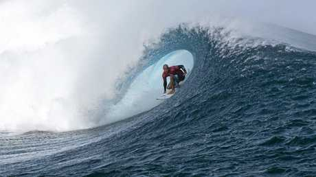Kelly Slater' doing what he does best in the barrel.