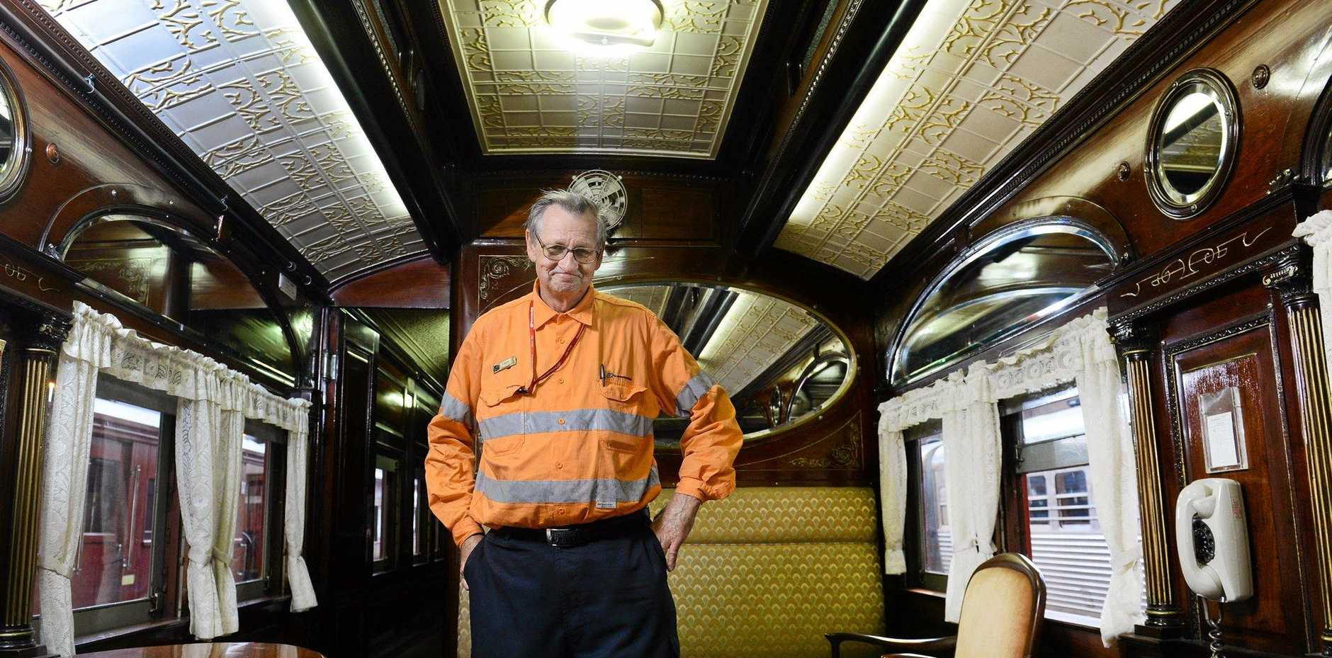 LUXURY: Queensland Rail volunteer Fred Holder inspects work on the 1903 Vice-Regal carriage being prepared by QR staff for the Governor of Queensland.