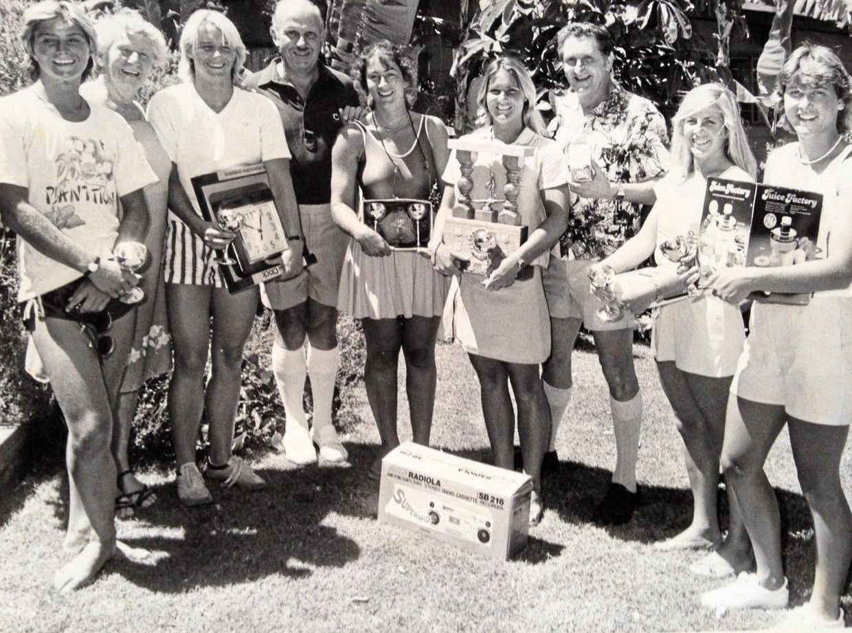 SURF GIRLS: (from left) Jodi Cooper, Ma Bendall, Helen Lambert, former Noosa mayor Bert Wansley, Simone Day, Toni Sawyer, former State Member for Cooroora Gordon Simpson, Pru Howarth and Jenny Gill at the Big Dairy Summer Surf Classic prize presentation, Australia Day weekend of 1983.
