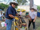 Malcolm and Reagan Jenkins with their vintage corn grinder at the Wolvi Vintage Machinery and Market Day in 2014.