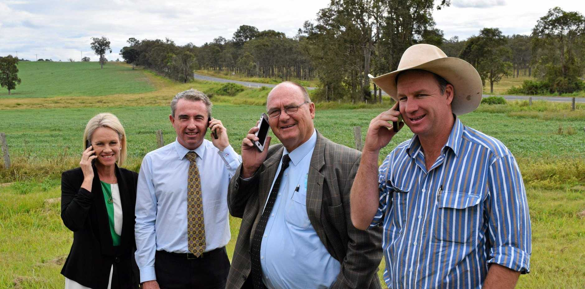 Minister for Regional Communications Fiona Nash, Page MP Kevin Hogan, Richmond Valley Mayor Ernie Bennett and Casino livestock agent Matt McCormack, near where a mobile phone base station will be erected north of Casino, if the coalition are elected. Photo: Rodney Stevens/ The Northern Star