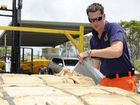 Clarence Nambucca Region State Emergency Service volunteer Denise Hurcum and Region Learning and Development Officer Darryl Bailey load tarps and sandbags into a trailer to be taken to Urunga. Photo JoJo Newby / The Daily Examiner